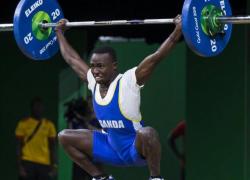 Uganda's weightlifter Julius Ssekitoleko who...